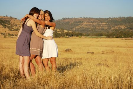 Young women in a dried grassy meadow Stock Photo - 3654766