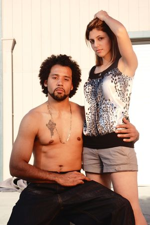 Young multi ethnic couple outside an urban warehouse photo