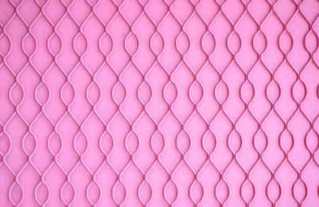 wire mesh: Wire mesh on a wall painted bright pink