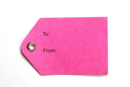 Pink gift tag isolated on a white background photo