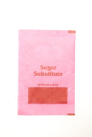Small packet of sugar substitute isolated on white background