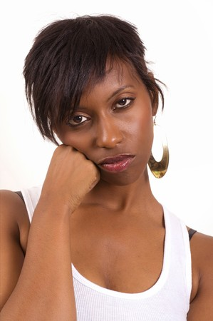 Portrait of a bored African American woman on white background