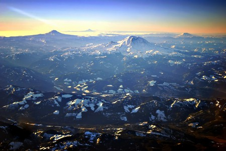 Sunrise over the Cascade Mountains in Washington State with Mt. Rainier in foreground photo
