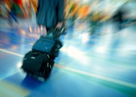 fast foot: Travelers rushing through an airport terminal Editorial