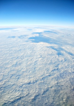 Scenic viewpoint from above and below clouds in the sky