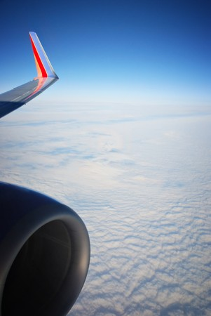 Scenic viewpoint from airplane above clouds in the sky photo