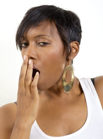 yawning: African American woman tired after a late night