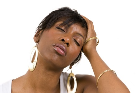 Young African American woman with headache holding head