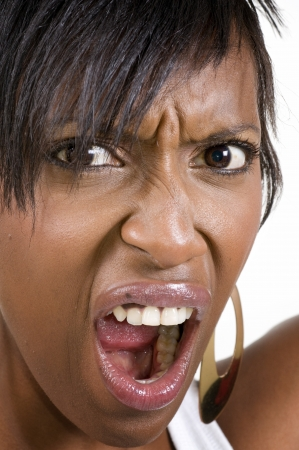 mouth close up: Angry young black woman shouting and screaming Stock Photo