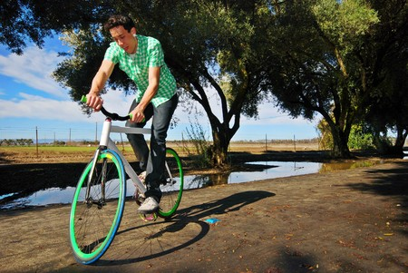 road bike: Young man balancing on his fixed gear bicycle