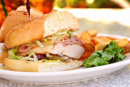 cordon: Grilled chicken cordon bleu with ham sandwich at an outdoor cafe Stock Photo