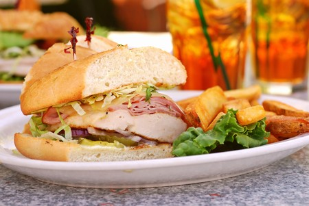 Grilled chicken cordon bleu with ham sandwich at an outdoor cafe photo