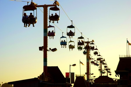 Silhouette of the Gondola at sunset on the Santa Cruz Boardwalk in California photo