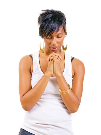 Young African American woman in prayer isolated on white