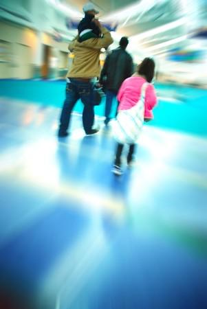 Family of travelers rushing through an airport terminal photo