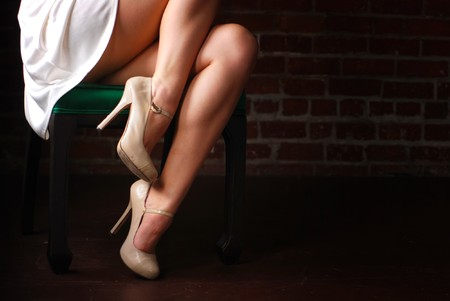 legs heels: Woman sitting in chair with legs and stilettoes