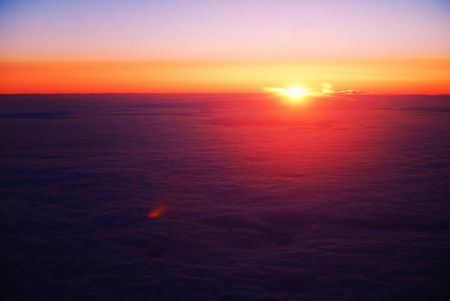 Sun breaking above clouds at 3500 feet above sea level photo