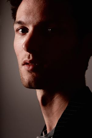 High contrast portrait of a young caucasian man Stock Photo