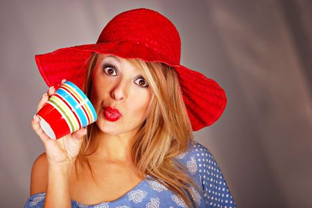 teenaged: Blonde teenaged girl drinking coffee from ceramic cup Stock Photo