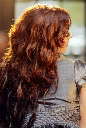 Woman with long auburn hair