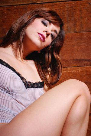 nightgown: Portrait of caucasian woman dressed in lingerie inside barn