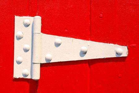 hinged: Painted white door hinge on red painted door
