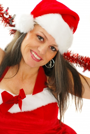mrs: Middle aged woman dressed in sexy Santa outfit Stock Photo