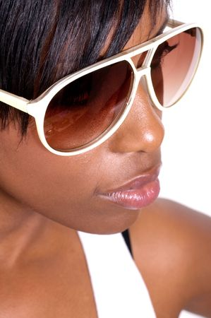 facial features: Young African American woman wearing sunglasses isolated on white