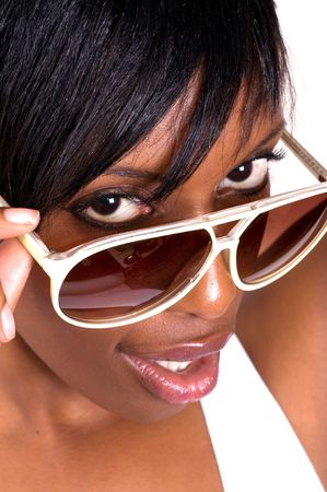 Young African American woman wearing sunglasses isolated on white photo