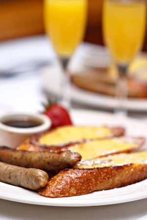 Sunday brunch with French toast, applewood smoked sausage and mimosas