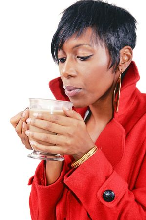 Young African American woman drinking a hot mochaccino photo