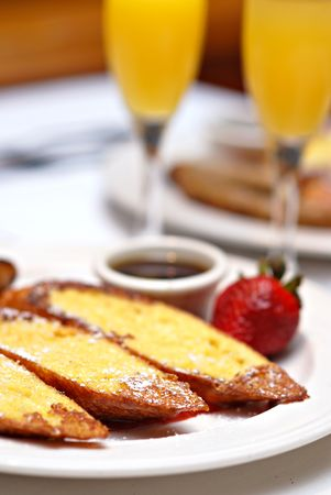 Sunday brunch with French toast and mimosas