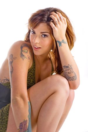 Portrait of a sexy young woman with multiple tattoos Stock Photo - 4945452