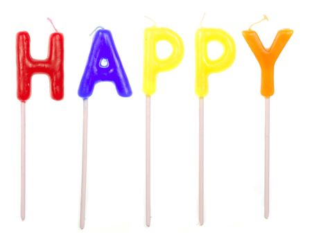Candles spelling Happy isolated on white background photo