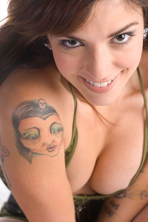 Portrait of a sexy young woman with multiple tattoos Stock Photo - 4980481