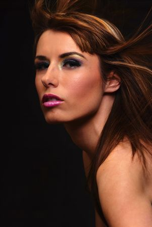 Young brunette model with hair blowing in wind Stockfoto