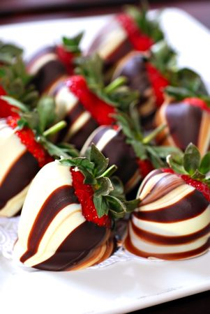 chocolate covered strawberries: White and brown swirled chocolate covered strawberries on platter