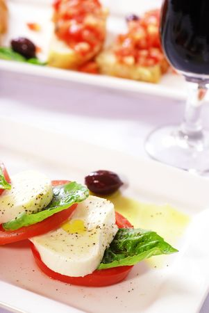 Two plates of appetizers in a restaurant Stock Photo - 5760585