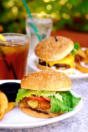 Teriyaki burger with large French fries at an outdoor restaurant