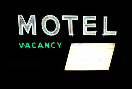 shop sign: Motel and vacancy neon signs with message board isolated on black background