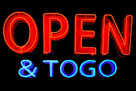 Open and To Go neon sign isolated on black background photo