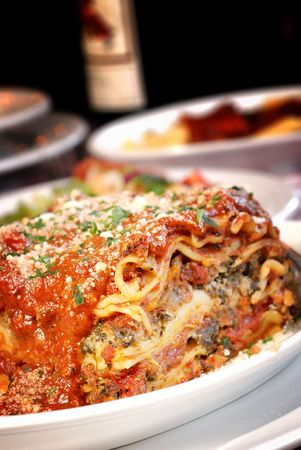 Plate of lasagna at an Italian restaurant Stock Photo