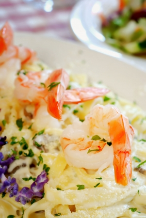 Plate of shrimp fettuccine on table at Italian restaurant Stock Photo - 5619391