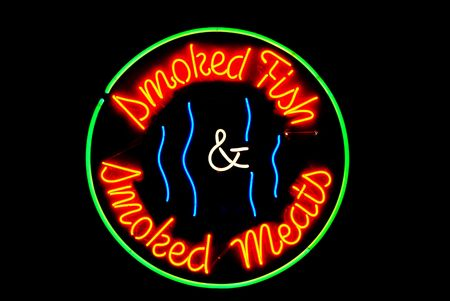neon fish: Smoked meats and fish neon sign isolated on black Stock Photo