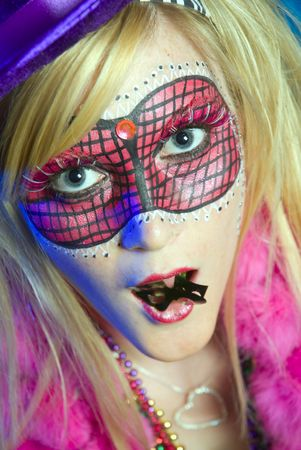 painted face mask: Blonde woman dressed up for Mardi Gras party