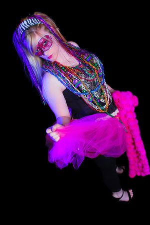 Blonde woman dressed up for Mardi Gras party photo