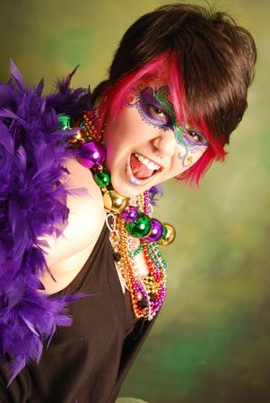 Portrait of a young woman dressed up for Mardi Gras photo