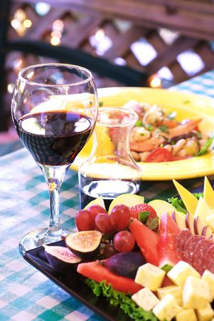 syrah: Glass of wine with dinner and appetizer