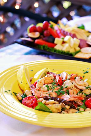 Mediterranean shrimp with sauteed vegetables and white beans photo