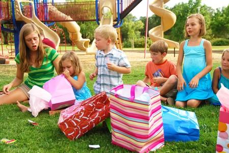 birthday party kids: Group of children celebtate girls birthday at a park